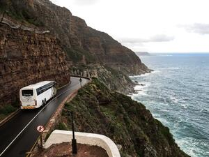 white-bus-on-road-near-cliff-1178448