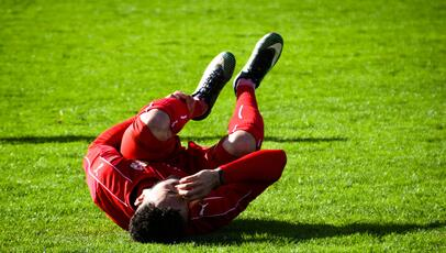 soccer player with cramp