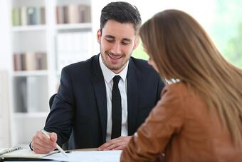 Woman meeting financial adviser in office