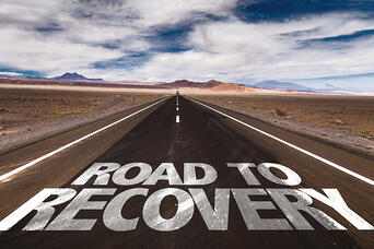 Road to Recovery written on desert road | Addiction Counseling Degree Programs | National Recovery Month Celebrates 30 Years