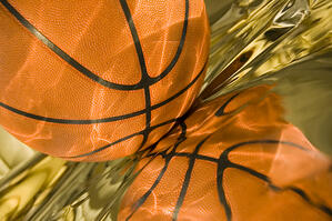 Sunlight playing on basketball and its reflection